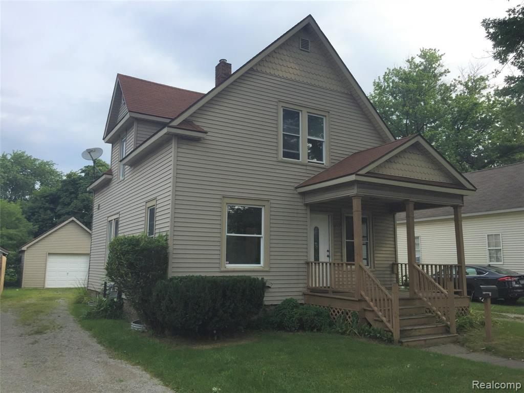 This unique 2 story home has beautiful old woodwork throughout, covered front porch, deck & 1 car detached garage.  This property has 1,369 sq. ft. of living space with 3 bedrooms, 2 full baths, new carpeting and painting throughout.  This home is situated on a 50x256 lot and walking distance of Garfield School, Lake Huron and several Parks.