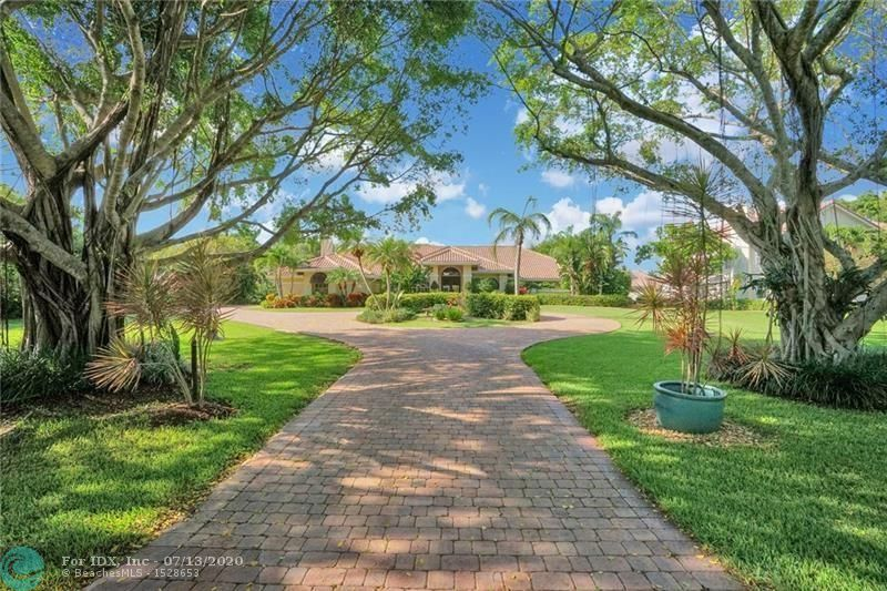 Located on a quiet cul-de-sac, this lakefront, .76 acre estate offers Cypresshead's finest opportunity!  Outstanding features incl: split BR plan with #2 adjacent to MBR & used as office;Master suite w/hardwood floors, plantation shutters & his & her walk-in closets; exquisitely updated bathrooms; stunning LR w/dramatic, high volume ceiling & vanishing sliding glass doors opening to pool & lake view; gorgeous kitchen w/rich wood cabinets, granite counters, gas cooktop & st. steel appliances; spacious FR w/beautiful fl-to-ceiling fireplace; pool table/game room area; custom wetbar w/access inside & out; expansive, screen-enclosed patio w/spacious covered area, & oversized, gas htd pool & spa; '07 roof and all impact windows and doors!!  Private yard boasts fruit trees & breathtaking views!!
