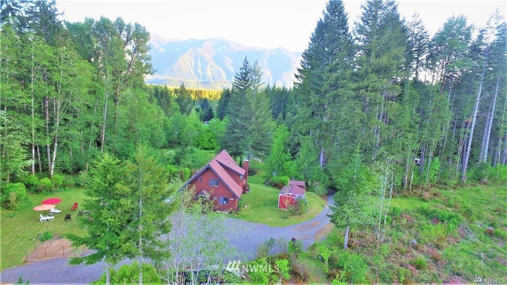 """CASCADE MOUNTAINS DREAM GATEWAY! Beautiful, 1,727 sq. ft., 2 Story Cedar Exterior Swiss Chalet Style Home. 3 bed/2 ba home w/ spectacular warm southern exposure, cedar living room w/ 4newly installed LG picture windows overlooking 5,400 ft Tumwater Mountain. On 5.78 forested acres w/ large timber, open space w/ walking trails & only 1.5 miles from Scenic Scanewa Lake!Exceptional views from every angle! Locatedon an ancient ridge that looks over the Cowlitz River Valley w/almost 360-degree view of  Cascade Mountains. If you ever wanted to escape the city to a paradise in the mountains, this is it! Perfect place to rent as an """"Airbnb"""" for extra income. MUST SEE to appreciate it! Make your appt today!!! Internet service provider is satelight"""