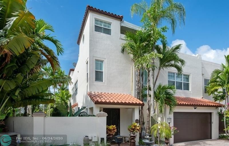 Fall in love with this beautifully updated three-story townhouse, just steps to Las Olas Blvd!! This corner unit's open floor plan, lots of natural light & private pool make it feel more like a single family home! Features include 2 car garage w/ plenty of extra parking, lush landscaping, high end finishes throughout, all impact doors & windows, walk-in closets, maple & porcelain floors, security system & Lutron lighting. Eat-in kitchen with high end appliances. Two large suites plus a den/office that can be converted into a 3rd bedroom. Enjoy City views & breathtaking sunsets on the rooftop terrace - equipped with summer kitchen, sauna, outdoor shower, jacuzzi & plenty of space for entertaining. Close proximity to fine dining, shopping, the beach & airport.