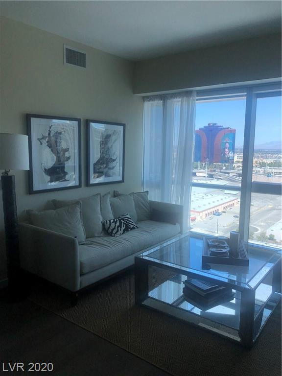 Beautiful condo that is a former model unit. Upgraded flooring and backsplash. Built in Platform bed and shelving in 2nd bedroom. Walk to City Center and center Strip. Luxury awaits at The Martin.