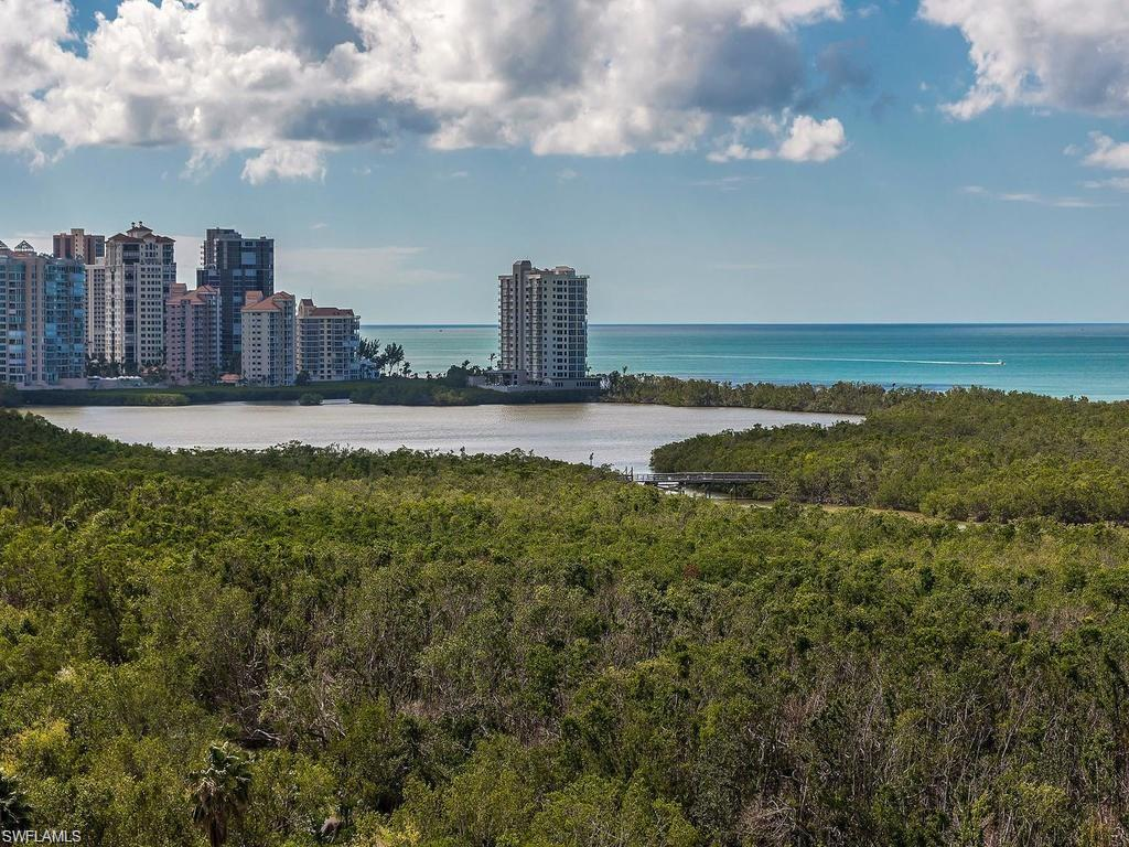 Gorgeous Gulf and sunset view from SW side of luxury tower. Contemporary renovations  enhanced with impact sliders and windows make this highly desirable cloud home a prime acquisition. Under building garage parking included. The building has been fabulously renovated in all common areas. Easy access to the tram and beach with a sunny pool and grilling area. Amazing fitness center on site as well as guest suites. All the best of the Pelican Bay 5 star resort lifestyle awaits you.