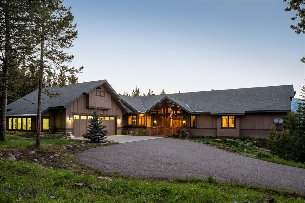 This 4 bedroom custom home is nestled amongst the tall pine trees at the highest point in Spanish Peaks North on 3.65 acres. The comfortable and cozy great room boosts a warm crackling fireplace, along with the kitchen, laundry room, office, and master bedroom which are located on the main level with high vaulted ceilings. Located off the oversized garage is a greenhouse, and a woodworking shop, while the lower level of the home has an additional 3 bedrooms, a family room, a wet bar, and a sauna off the back patio.  The covered porch off the dining room will be an amazing location to snuggle up with a book, or just enjoy the quiet peaceful outdoor space. This home is waiting for you and your family to create long lasting memories that will last a lifetime!