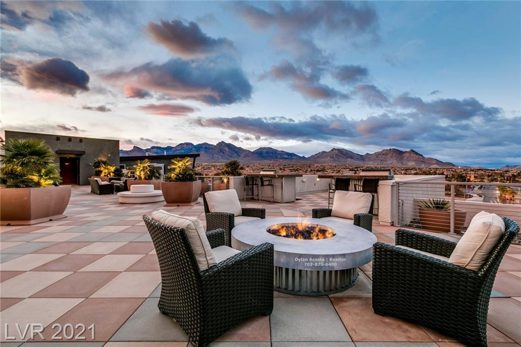 Very Rare North Facing Loft Condo in the Most Prime Summerlin Area. The Architecture and Quality of This Building are Unmatched in Las Vegas. Rooftop Deck with 360 Degree Views of Las Vegas. UNIT FEATURES: 1 Downstairs Bedroom and Bath, 1 Upstairs Master Loft, Floor To Ceiling Windows, Stainless Appliances with Viking Refrigerator, Large Balcony with the Best Mountain Views Las Vegas and Summerlin Has to Offer. 2 Minutes from Downtown Summerlin.