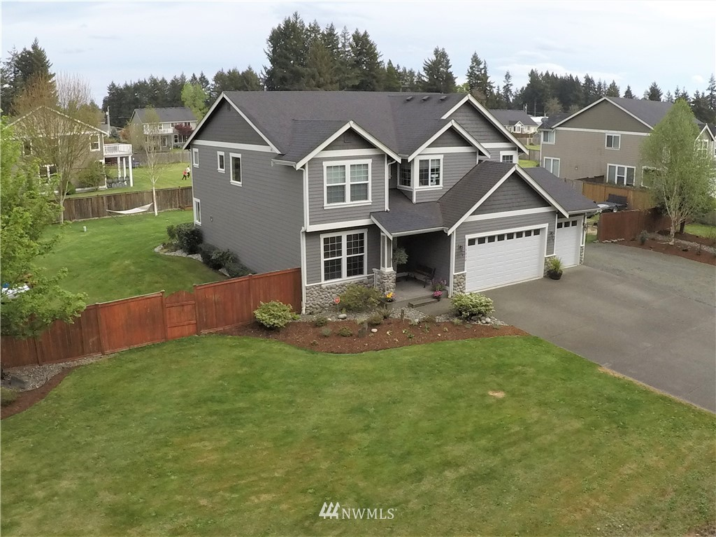 Ideal dead end street location with easy access to I-5!  This 2 story beauty boasts 4 beds, 2 3/4 bath on shy 1 acre parcel. Vaulted 9ft. ceilings, tile counters in kitchen with lrg. island,walk in pantry,  formal dining area,  hardwood floors, 5p master suite with gorgeous private deck & walkin closet. on upper level + 3 add. bedrooms + bonus rm. on main. A theatre room complete with projector, above ground pool,  3 car attached garage. Too much to list, call for showing today!
