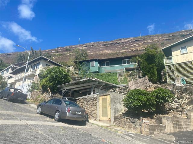 """This home will need your tender loving care or build your dream house with spectacular view of Hawaii Kai residence, with ocean and mountain view.  Two separate entrance with rental income.  Actual improvements square footage may not match the tax records. Sold """"As Is"""". Seller will not make any repairs.  Please drive by first,  steep and both side stairs need repairs.  Seller live in this house for 60 years."""