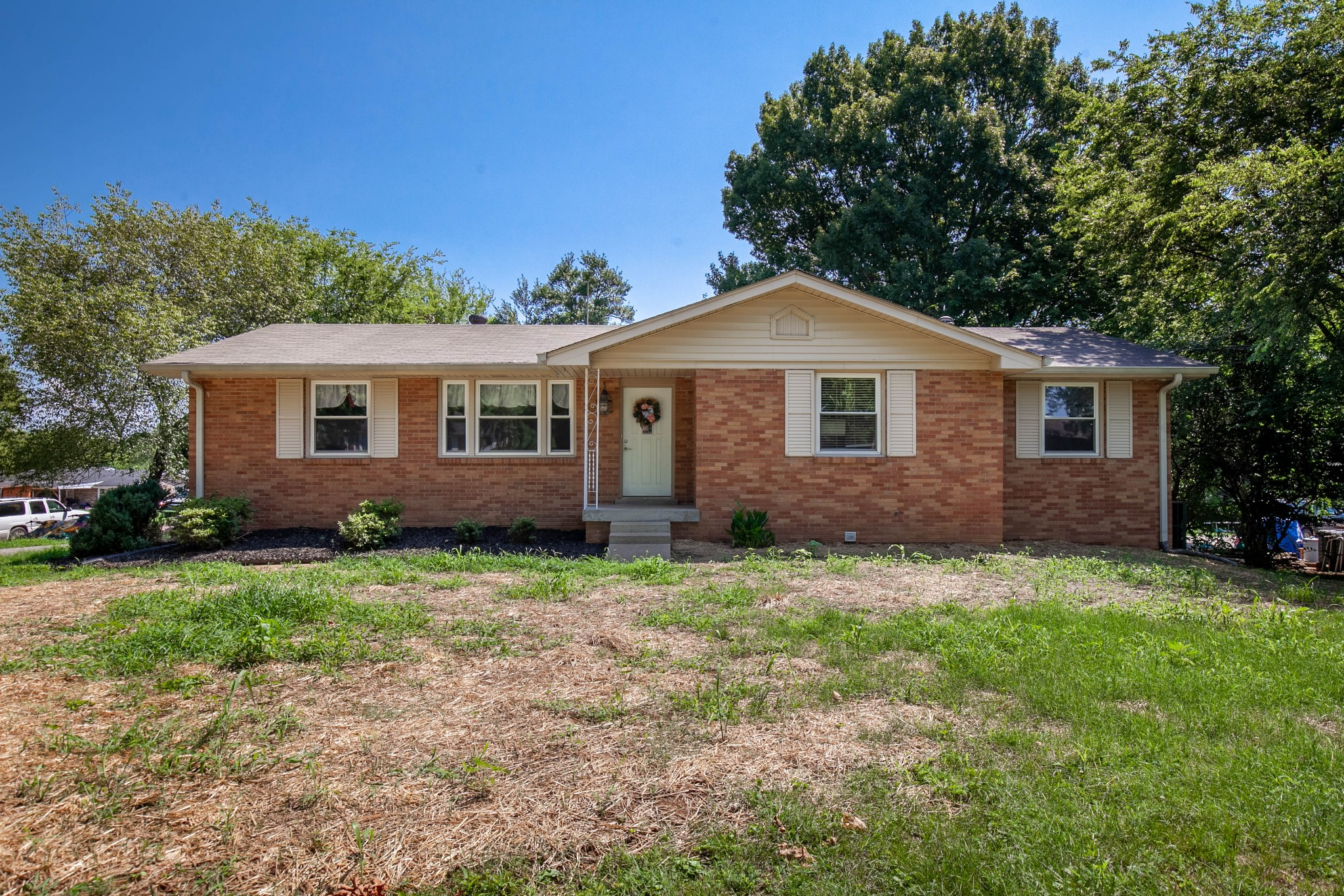 Great location-Minutes from Streets of Indian Lake & Hwy 386 Bypass! Updated Kitchen! New Windows, Newer Roof, Original hardwoods throughout main level. Screened in Porch! Tile floors & wood burning fireplace in partially finished basement! Indian Lake Peninsula schools. Great bones, great potential!