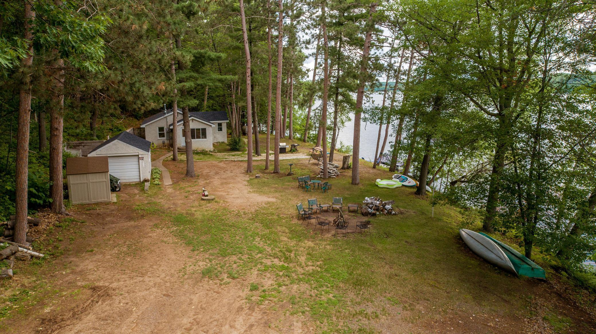 Here is your opportunity to enjoy 308 feet of shoreline and 3 acres of land on private Eagle Lake; which has no public access. Eagle Lake provides exceptional fishing and recreation options. This hard to find property features a 2 bedroom 1 bath home situated near the waters edge with updated cabinetry, spacious living room, four season porch, and new roof. The easterly views and serenity of this property are tough to beat! A true up north escape!