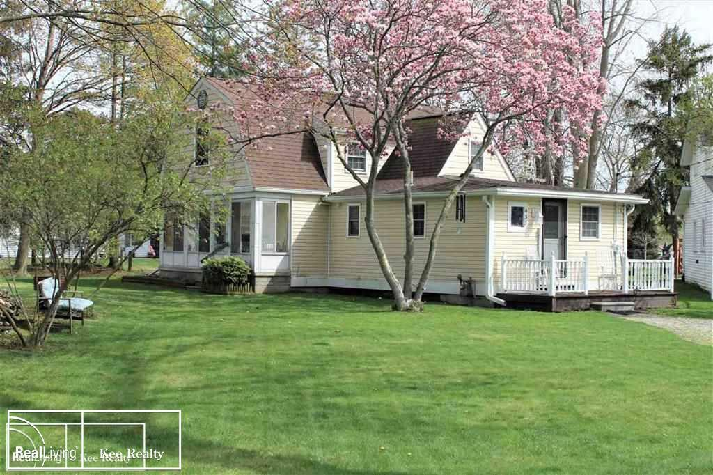 JUST IN TIME FOR SUMMER! 165' OF CANAL FRONTAGE and 37' BOAT WELL. Only 5 min ride to St Clair River (no bridges) Well maintained 3 BR, 2 full baths, and a nice seasonal sunroom overlooking the canal and beautiful park-like property provides you a total of 1,350 sf of living space. Home has been completely remodeled inside and out with updated kitchen, large eating area (stove, microwave, refrigerator & DW incl)Both baths include ceramic tile floors, new vanities, toilets, & Kohler fixtures. First floor laundry area with walk-in utility closet off kitchen. Unique 2nd floor with 3 BRs and huge Nook for extra storage or closet space. The Historic Pointe DuChene Subdivision is walking distance to community swimming area at the River and Downtown Algonac.