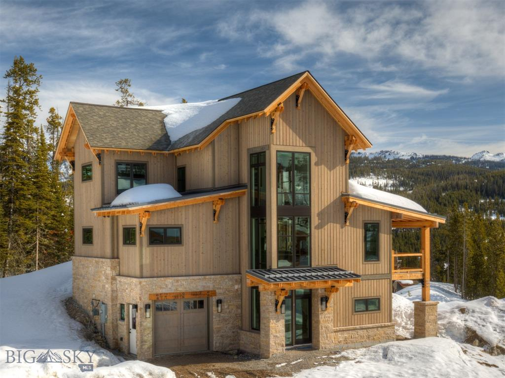 Welcome home to the Homestead Chalets, Big Sky Resort's most recent free-standing condominium neighborhood. This spacious chalet offers mountain modern finishes and a professionally designed furniture package. Featuring 6 bedrooms and 5 bathrooms in over 3100 sq.ft.of livable space with ski access to the White Otter chairlift. Enjoy panoramic views of the Spanish Peaks, Lone Mountain, and the Gallatin Range throughout the chalet. The lower level boasts a family room, 2 bedrooms (one of which is a large bunkroom), and a bathroom. The sunny main level has the living room, kitchen, dining area, master bedroom and bathroom, an additional bathroom with a shower, and the laundry room. The upper level offers a second en suite master bedroom, and 2 additional bedrooms and a bathroom. Relax after a day of Big Sky's outdoor activities on either the side deck, or the private back patio which offers a hot tub.