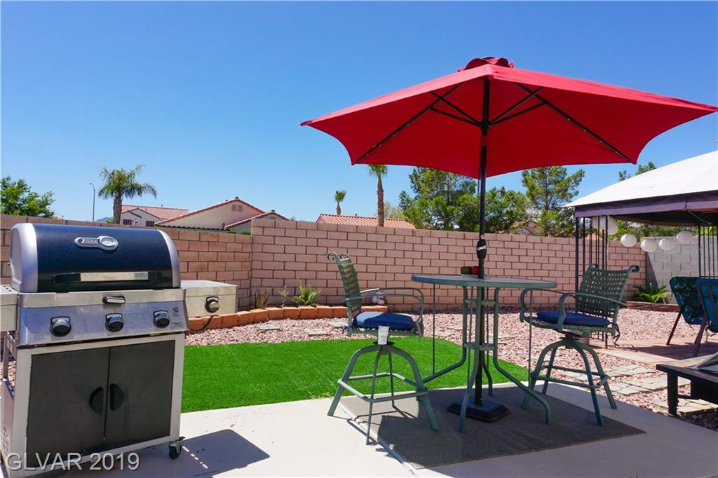 Single story in South Valley Ranch corner lot. Walk to parks & short drive to Cowabunga Bay, Henderson Hospital, Henderson Bird Preserve and Galleria. Super private lot, no neighbor to the side or back! Open & airy layout. 3 bedrms & 2 full baths. Solar, Ceiling fans & custom blinds. Very large master w/walk-in closet. Lots of cabinets in kitchen w/generous countertop area + walk-in pantry. Private, low maintenance yard ready to start the BBQ!