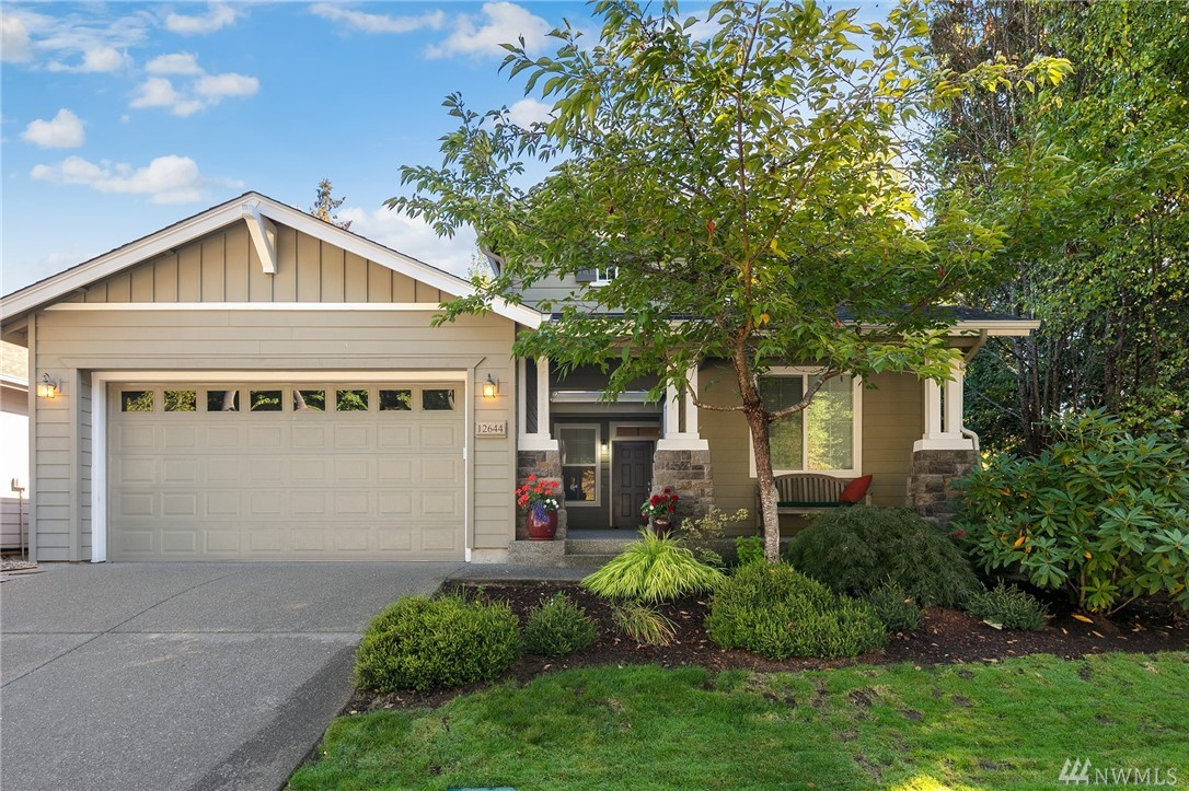 Welcome to one of the most private homes in Trilogy - 6th tee of Redmond Ridge Golf Course w/greenbelt. At time of construction golf course lots incl $100,000 lot premium - one of a kind setting! Vashon plan - open concept Great Room w/hdwds. Granite & stainless Kitch w/island. French doors to patio & garden space. Mstr w/sunny golf course facing bay window. Private 3rd room - office or guest room. Many builder upgrades. Amazing Trilogy Clubhouse, trails & more - truly resort living in Redmond.