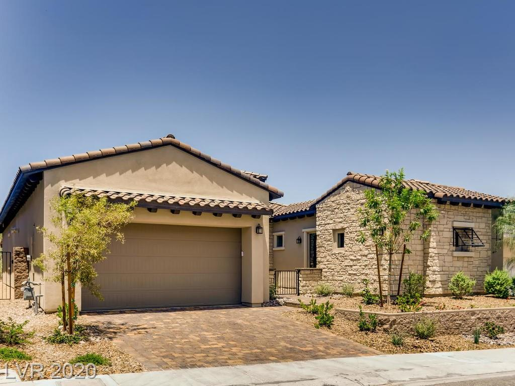 LAKE LAS VEGAS LIVING WITH A VIEW...HIGHLY UPGRADED SINGLE STORY HOME WITH CUSTOM FINISHES, UPGRADED KITCHEN AND APPLIANCES. FAR TO MUCH TO LIST. DON'T LET THIS ONE PASS YOU BY.