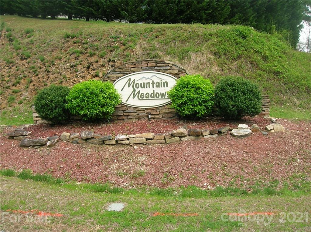 Phase III Mountain Meadows. Great views, stream, open areas, stick build or off-frame modular. 1600 sq. ft minimum with 2-car garage required. Common area with small waterfall, picnic area, foot bridge and stream. Enjoy watching the wild turkeys and deer. Minutes to town. Paved streets, underground utilities. Gentle topography. See attachments for more info.