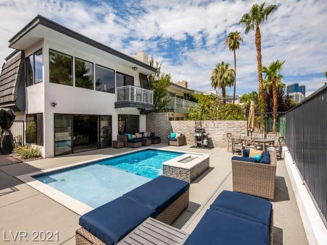 CUSTOM remodeled home in the iconic Las Vegas Country Club! Located near the 16th fairway with golf course and Stratosphere views from your pool. No detail with the structural, mechanical, electrical or interior was spared in the renovation. This 3 bed, 2.5 bath home has the charm of its history and the modern and contemporary design of today. Furniture is negotiable except for art, chandelier in the master bath and a few other pieces.