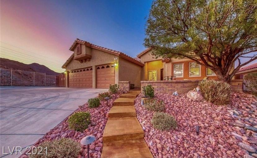 Amazing Single Story w/mountain views on large corner lot! Features over-sized driveway/RV parking w/50 amp plug. Beautifully landscaped w/courtyard entry. Spacious living & formal dining room w/neutral color palette. Kitchen boasts granite counters, tile backsplash, custom cabinets & overlooks family room w/fireplace. Sprawling primary bedroom w/walk in closet & gorgeous bathroom. Private low maintenance backyard w/covered patio! Solar panels for energy cost savings.