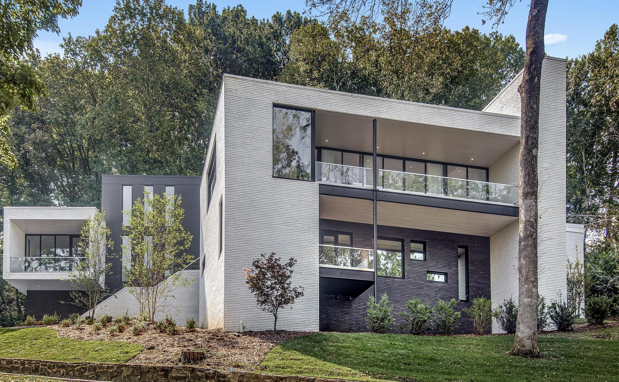 Priced significantly below recent appraisal. A once in a lifetime opportunity. 2019's top contemporary New Build perched atop a 1.4 acre hillside in Green Hills. Green views by day & twinkling city lights at night. Open concept 8,400 ft. on three levels / 3 car garage, amazing outdoor entertaining spaces. Walls of commercial glass windows,15' ceilings & deep set clerestory windows accenting a sumptuous main level gathering area. Top of the line Sub Zero, Wolf appliances, impeccable finishes.