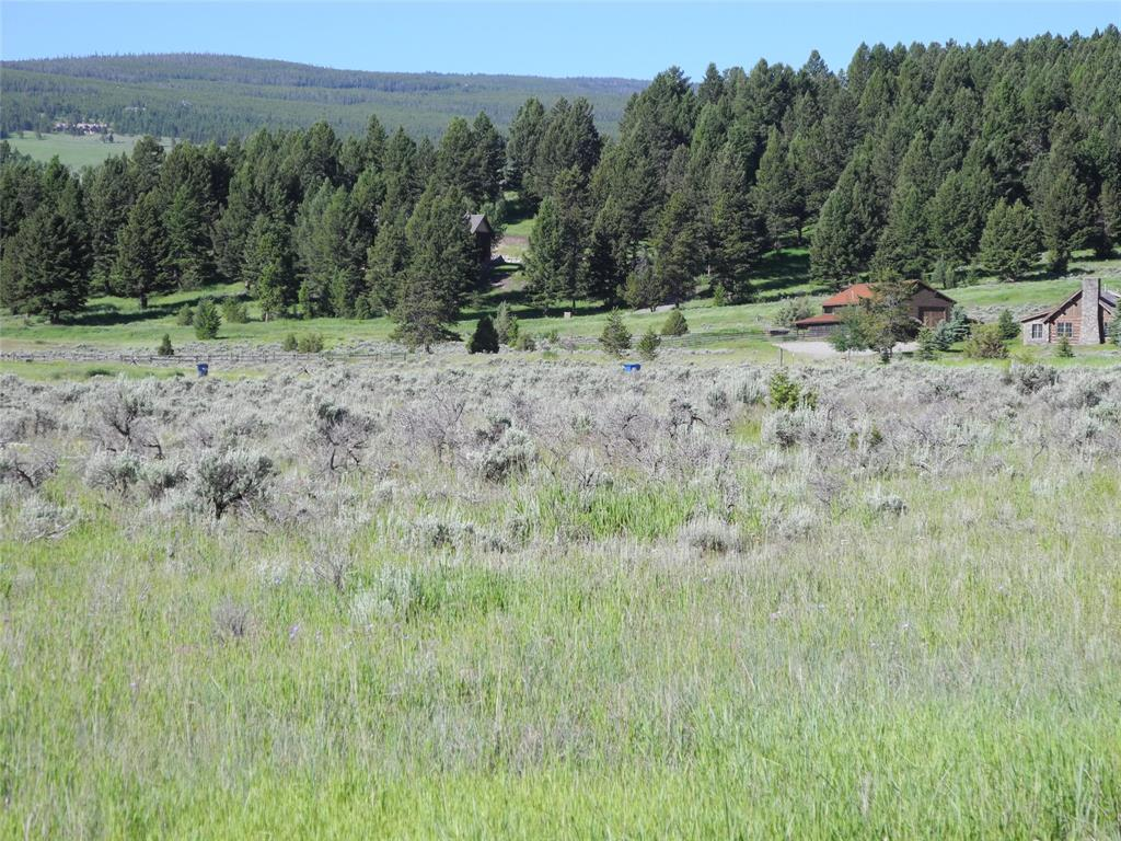 Wonderful flat corner lot, locate close to the Big Sky school facilities and Warren Miller Performing Arts Center.