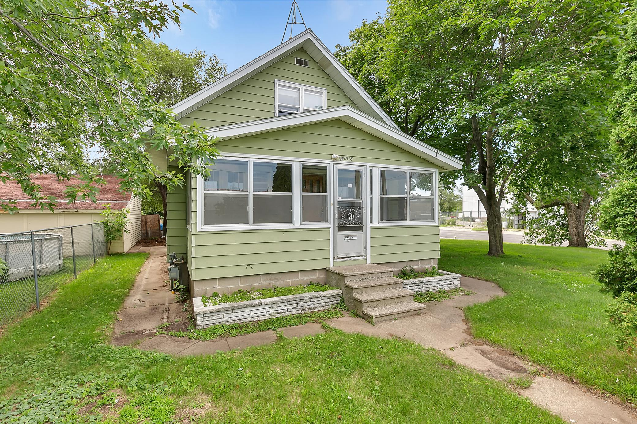 Large three bedroom home on corner lot.  Two bedrooms on mail floor with orginal hardwood floors.  Large finished basement makes a great space for a lower level living room or office.  Three season front porch and detached one stall garage.  Only a few minute's walk to groceries, restaurants, and shops.  Quick access to downtown, parks, and major shopping areas.  The perfect home for an owner occupant or rental property.