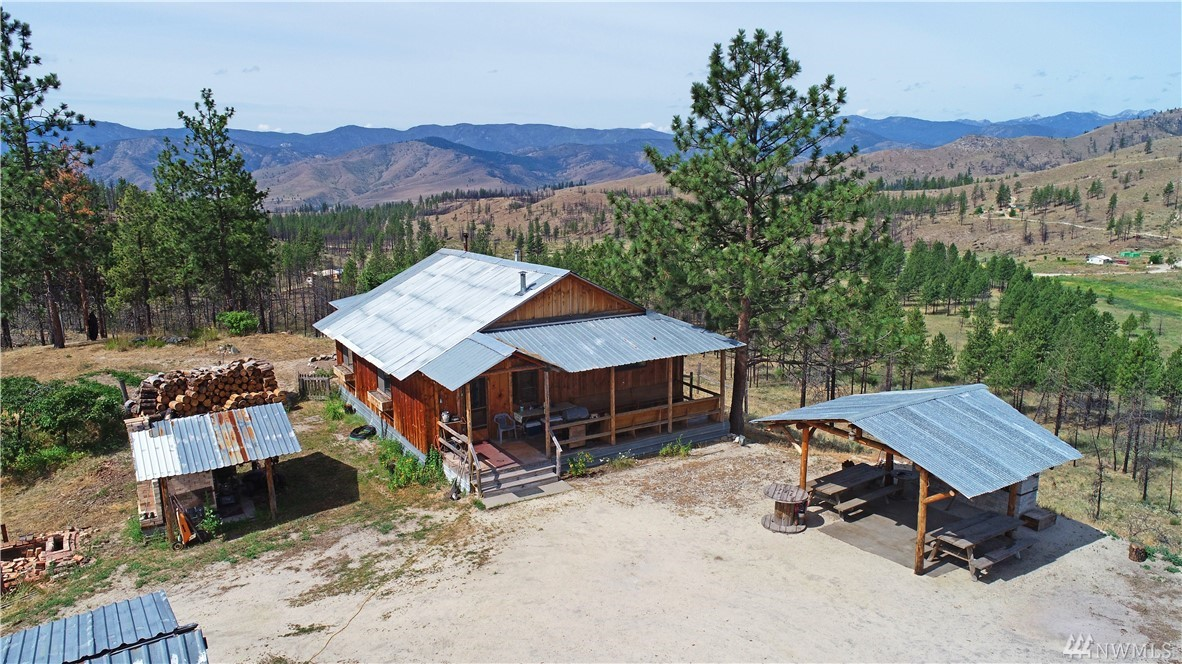 Off-grid living on 30 private acres! Historic Methow homestead cabin. Charming additions to the original pickers cabin await you! Outstanding views, established garden, mature trees and privacy! Custom workmanship thru out. Reclaimed hardwood floors, handmade kitchen tile, custom cabinets, antique Monarch stove + modern propane one too! Incredible views from covered outdoor kitchen with BBQ, pizza and bread oven. Potters studio, small barn + more! Live the quiet, off-grid life of your dreams!