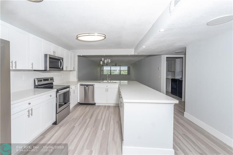 If You're looking for a Condominium In Sunrise Lakes Phase IV that feels like Brand New Construction with High End Finishes then Look no further. If you want the best and not the cheapest then you've found it. Owner has spared no Expense Completely Remodeling this huge 1420 sq ft Unit with Incredible Long Lake Fairway Golf Course Views right across from Satellite Pool. See List of Improvements in Supplemental Remarks. Ready to move?