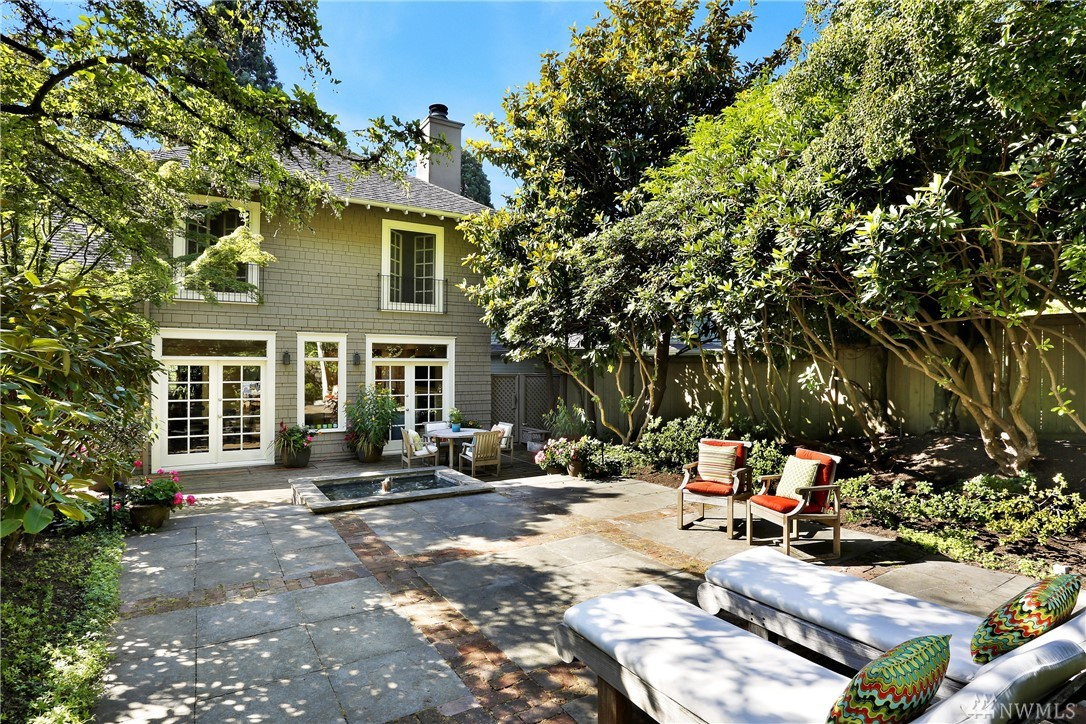 Classic architecture + a sought after location add up to an unsurpassed opportunity. Vintage details meld seamlessly with recent improvements. Nearly 12,000 sq foot lot offers private, park-like setting with mature trees, shrubs, a fountain, patio's & a deck. Located in Seattle's favorite neighborhood, access to most everywhere is a breeze - steps to Volunteer park and a short walk to Seattle's best restaurants & shopping; I-5/Hwy 520 are minutes away. Welcome to life on gorgeous Federal Avenue!