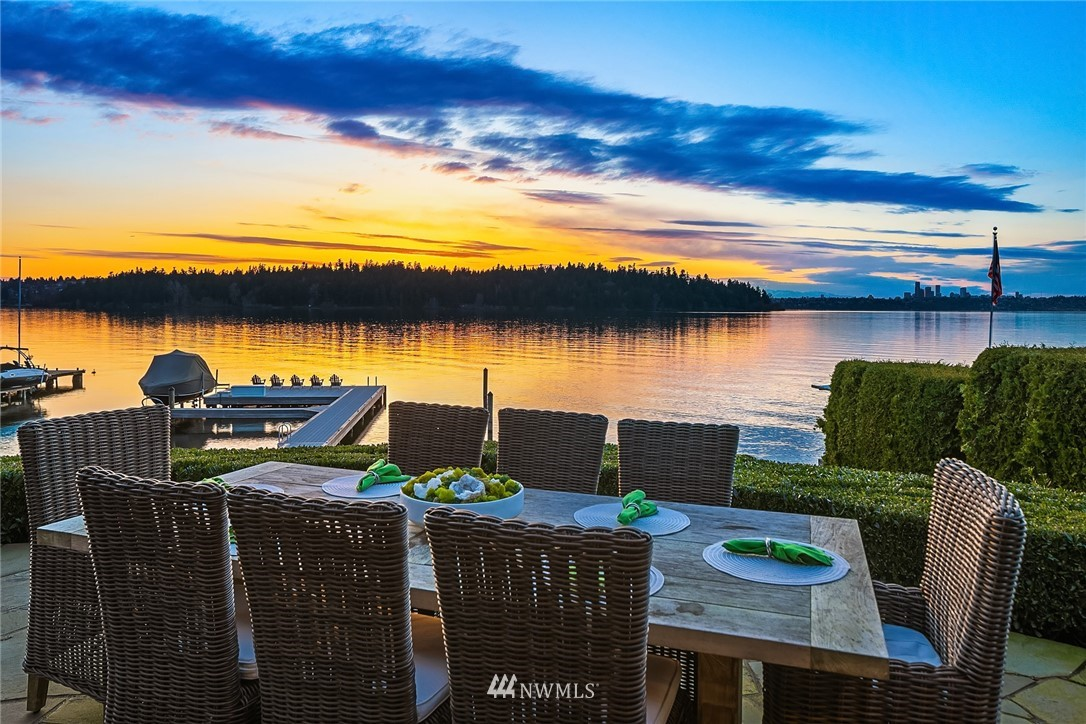 The one you have been waiting for. Unparalleled, walk-out waterfront. Perfectly sited to capture Western views of Seattle skyline & mtns along w/ breathtaking sunsets from 119' of prime Gold Coast.  This private & sophisticated estate exemplifies timeless Northwest elegance. Turn-key w/ exquisite amenities & finishes: completely remodeled by Beckes Homes, newly updated epicurean kitchen, wine cellar. Vaulted ceilings, open concept w/ ideal entertaining spaces designed for instant enjoyment, including expansive bluestone patios w/ firepit, hot tub & outdoor kitchen. Endless water sport opportunities from newer dock w/ huge platform lounge area, auto lift cover for 27' boat & deepwater moorage for 70' yacht. Lakefront living at its very best.