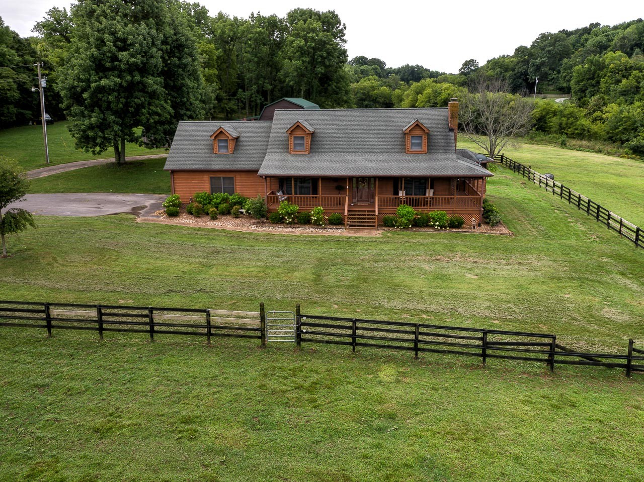 Beautiful 18+/- acre setting. 2,500+/- sq. ft. home with 3 bedrooms & 2.5 baths. Fenced acreage + additional wooded area. Great barn, set up for horses currently, pond with year round water, and place to play and roam. Looking for some acreage set up for a mini farm? Dreaming of all the things you could do if you had a little land? Look no further. Come see us!