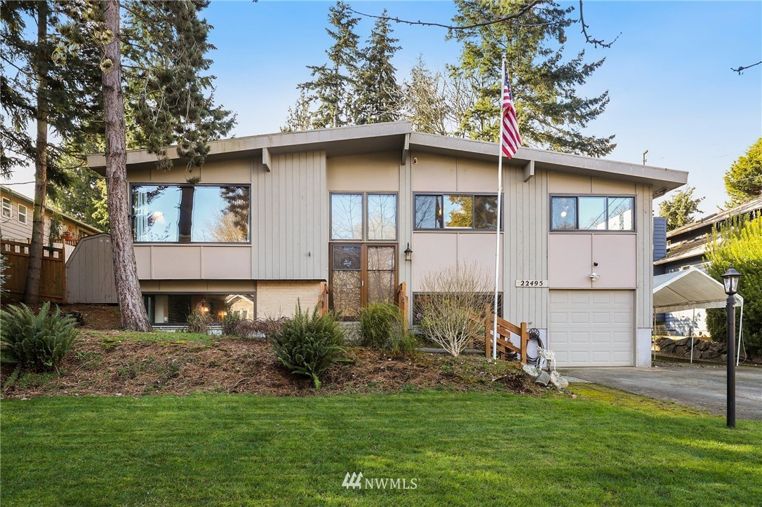 Welcome to this Beautifully Updated, Spacious home in a Prime location! Features gleaming hardwood floors & designer travertine tile in kitchen & bathrooms. Open Concept living, kitchen, dining room w/impressive fireplace & huge front windows. Gorgeous chef's kitchen boasts granite counters & new fridge. Master w/elegant 3/4 bath. Massive family rm on lower level along w/4th bedroom, large full bath & laundry rm. Spacious, almost 1/4 acre lot nestled in a park-like setting! Whole house standby natural gas generator w/automatic transfer switch. NEW furnace & water heater. RV parking w/alley access in back. 16 x 10 storage shed w/new roof. Fruit bearing cherry tree. Near parks, schools, shops, restaurants, waterfront & new light rail station.