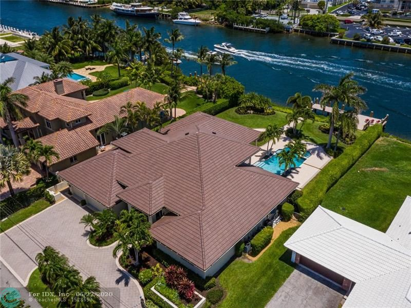 """Direct Intracoastal Estate On Unparalleled 1/2 Acre Lot (100x200) in NO Wake Zone """"1.3 Mile"""" To Hillsboro Inlet! Timeless Transitional Designed 5 Bedroom 6 Full Bathroom Home That Has Been Tastefully & Completely Updated And NEW In 2020 Master Bathroom & Suite And Complete New Slate Roof! Newer Composite Dock With Concrete Pilings! Grand Foyer Entry To Open Floorplan! Resort Pool/Spa (34x16) Native Gardens Overlooking Your Panoramic Water Vistas Of The Blue Waters Of The ICW! Impressively Large """"975 sq ft"""" Of Lanai Areas To Enjoy The """"Truly Ocean Breezes As Property Only 750ft From The Sand"""" Of Your Eastern Exposure Family Compound! MASSIVE """"900+ Sq ft"""" 3 Car Garage With Workshop Area! New A/C's And More! Walk To Nearby LHPYRC! Proudly Presented By """"The Lighthouse Point Specialists"""""""
