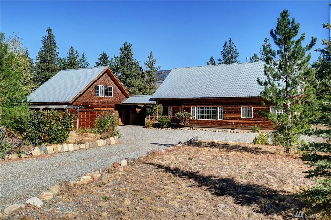 Spacious 4+ bdrm home on 2 acres in desirable Wolf Creek. Expansive great room, light filled thru out. MBR on upper w/ 2 walk in closets! Ensuite bath, walk in shower, soaking tub. 3 bdrms full & 1/2 bath on main. Loft for tv/family rm + 2 more flex rms! Gorgeous hdwds, pine log banister, T&G ceiling. Built ins. Tons of storage. Detached garage w/roughed in MIL. Large deck, garden space, low maintenance yard. Just a few kicks to the ski trails & minutes to Winthrop. Incredible, sunny location!
