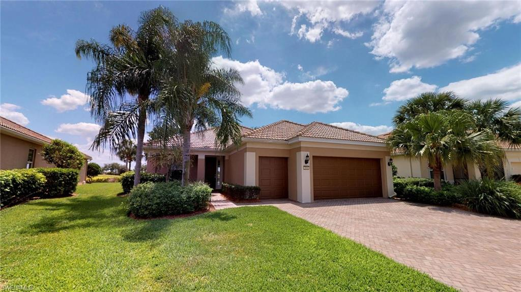 """H.15089 - Beautiful """"Shenandoah"""" Classic Series Home, Pool w/Spa, on Premium Lot, Golf Course &Water View, Spectacular Southwest Sunsets. Grandfathered Property, Buyer need not be 55 Plus. 1860 Sq. Ft., 2380 Total Sq. Ft., 2 Large Bedrooms, with Large Den, 2 Full Baths,2 Car Garage w/Additional Golf Cart Garage/Bay. Nicely Optioned; Tile Through Most,Granite Tops, Stainless Steel Appliances, Upgraded Cabinets, Under Cabinet Lighting,Separate Tub & Shower in Master Bath, Large Walk in Closet, Utility Sink in Laundry Rm,Security Alarm, Over-sized Covered Lanai, Plumbed Outdoor Kitchen w/Grill, Electrical Roll-down Shutters Front & Back, Heated Pool w/Spa. GOLF MEMBERSHIP INCLUDED!  Property Complimented by Oasis Club Resort Style Amenity Center – Activities Director, Semi-Private Championship Style Golf Course, and Restaurant. Truly a Must See! """"Come Experience the Beauty that is Ave Maria"""". Please Contact Listing Agent Directly for More Information on this Special Property."""