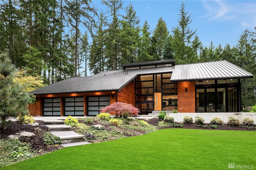 This custom home is a flawless execution of a Northwest Contemporary masterpiece. Sleek urban & minimalist design that captures open spaces while embracing comfortable living. Extensive customizations from glulam beam stairs & cable railings, LaCantina accordion doors, steel wrapped fp to in-floor radiant heating & more! Privately nestled on .85 acres of spectacular outdoor spaces incl gated driveway, 1500sf of patio/deck space, gazebo, water features, gas fire pit, turf throughout & sport court