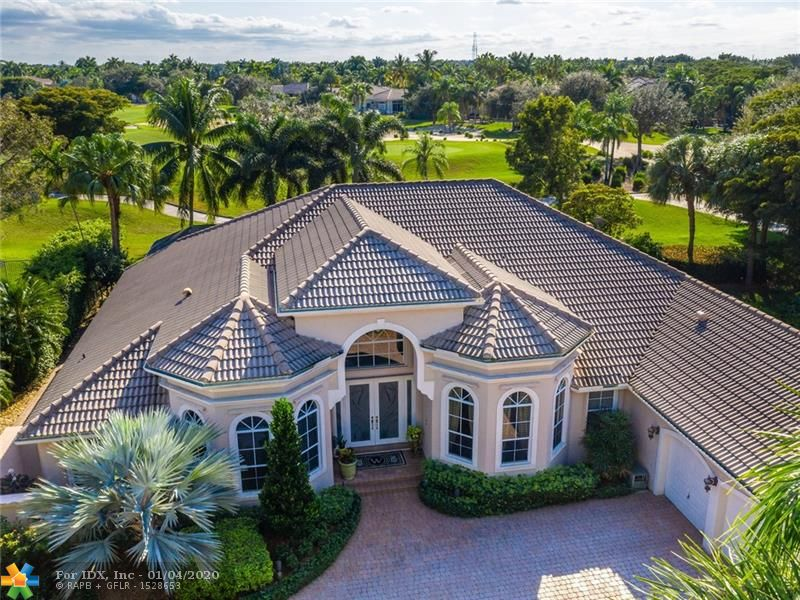 "WELCOME TO THIS ELEGANT & PRIVATE GOLF COURSE HOME THAT HAS BEEN BEAUTIFULLY MAINTAINED. LOCATED IN THE PRESTIGIOUS WESTON HILLS COUNTRY CLUB ON A SPECIAL LOT WITH ONLY ONE NEIGHBOR. 5 BEDROOMS+OFFICE 3.5 BATHS & TRIPLE SPLIT FLOOR PLAN. LARGE MASTER WITH SEPARATE SITTING AREA, DOUBLE CUSTOM WALK-IN CLOSETS & LUXURIOUS BATH. A CHEF'S KITCHEN THAT FEATURES A GAS RANGE, DOUBLE BOSCH OVENS, 42"" WOOD CABINETS, GRANITE COUNTERS, WALK-IN PANTRY+BUTLER'S PANTRY. SEPARATE BREAKFAST AREA, SPACIOUS FAMILY RM, FRENCH DOORS, PLANTATION SHUTTERS & CROWN MOLDING THROUGHOUT. HUGE SCREENED COVERED PATIO, HEATED POOL/SPA, ACCORDION SHUTTERS."