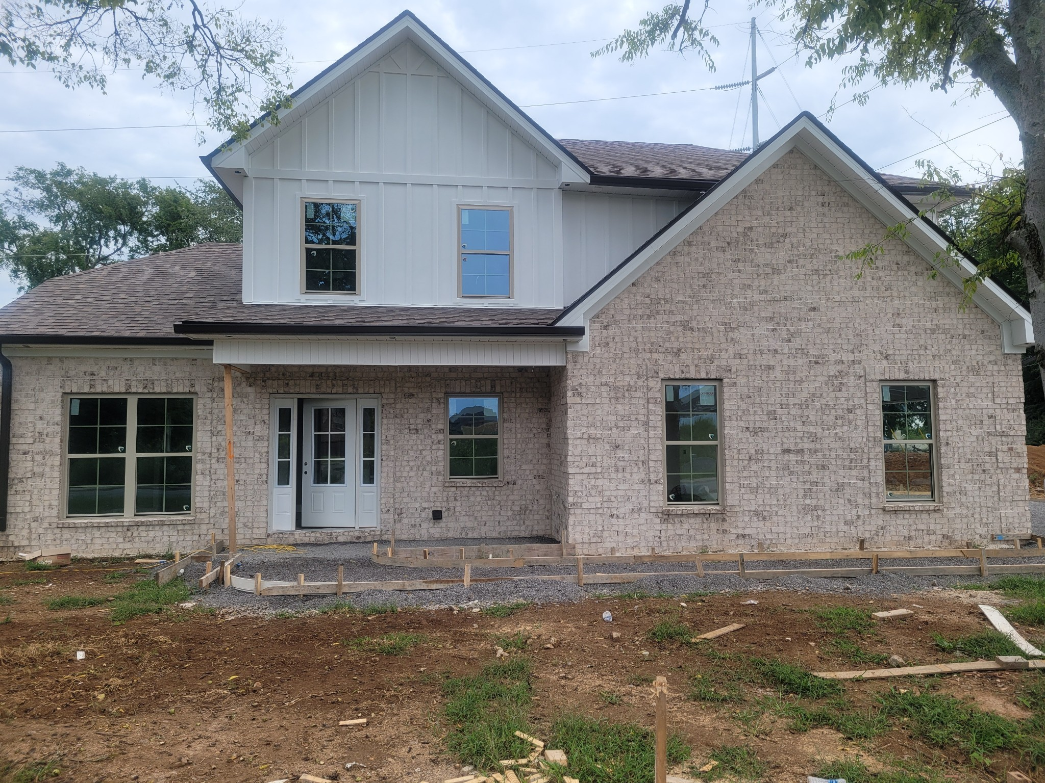 New brick home conveniently located minutes from I-24, Nissan, schools. and more, SS appliances, lam hardwood, tile floor, fireplace, open floor plan, lg walk-in-closet, nice size bonus area, covered back patio...Beautiful Home!!!!