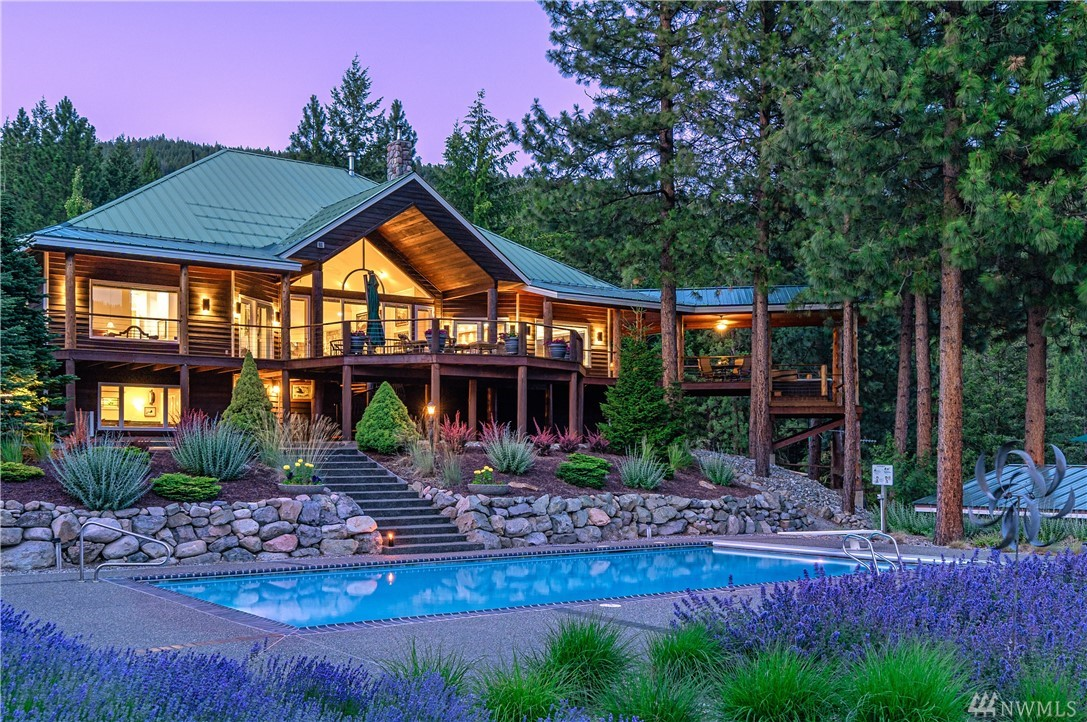 Escape the city to a private 3+ acre estate w/breathtaking Methow Valley views. Meticulously maintained 4,594SF 4bd/4.5bth Mountain Modern home features main-level living, vaulted ceilings, oversized windows, solar-heated pool, hot tub, pub, wine cellar & 2,400SF new cedar decks. Hardwood floors, river rock accents, remodeled kitchen w/custom cabinets & Spectrus granite. Irrigated landscape/orchard/garden, 3 garages w/7 bays, 2 shops, office, 20KW generator, tennis court, spacious loft & more.