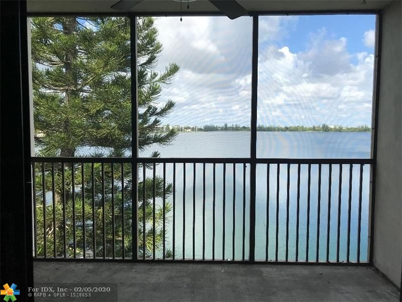 DIRECT WATERFRONT with views of largest freshwater lake in Broward.  Seems like you're on a cruise ship.  Imagine sitting on your balcony enjoying spectacular sunrises & sunsets, or strolling along 2 miles of sidewalks next to the lake, or fishing or kayaking after work.  This super clean move-in ready 2/2 was just painted & carpeted, has newish range & fridge (2 years), newer appliances (dishwasher & AC approx. 5 yrs old), AND washer/dryer inside unit. AMENITIES INCLUDE 24/7 Gym, 3 Pools & Jacuzzi, Library, Basketball, Tennis, Pickleball, Paddle Boats, Canoes, Sailboats, Tiki huts & grills, Fishing, Bingo, Game night, Yoga, Art classes. Gated community with guard at gate.  Roaming Security guards. Premium cable included.