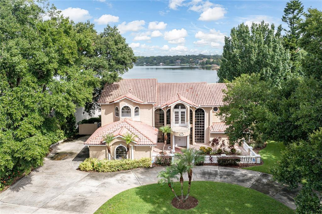 OUTSTANDING OPPORTUNITY TO LIVE LAKEFRONT IN EXCLUSIVE, GATED SPRING LAKE HILLS! Custom 4 bed/3.1 bath 4,577 sf Mediterranean pool home on .39 acres has a beautiful long view of private Spring Lake. Amazing foyer & soaring ceilings welcome you to 22x22 Great Room leading to the lakefront lanai. With a breakfast bar and eat-in alcove, the kitchen also offers stainless appliances and granite counters and plenty of storage. Large formal dining room is ideal for family gatherings. Spacious Master Suites (downstairs with attached Exercise Room + Sauna & upstairs with Palatial Bathroom with dual sinks, jetted tub and walk-in shower & huge walk-in closets). Two spacious secondary bedrooms upstairs with accompanying full bath. Boat dock with lift & 3-car side entry garage with room for jet ski or golf cart. Other amenities include security system, interior laundry and central vacuum. No carpet anywhere for an allergen-free environment. Community features include 24-hr guard gate, playground, tennis, basketball and 2 boat ramps. Conveniently located with easy access to I-4 corridor. WECOME HOME!