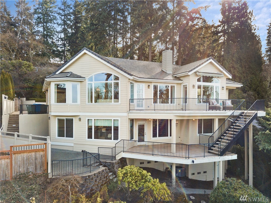 Designed to capture western views of Lake Washington, sunsets, mountains, and city. This custom home offers an extraordinary level of detail and quality. Luxurious main floor master suite. Incredible finish work is evident in the millwork and built-ins found throughout the home. Walk-in wine room. Entertain on the multi-level, connected view decks. A/C. Concrete tile roof. Heated separate storage room. Low maintenance yard. Coveted 3 car garage + additional parking. This is the one!