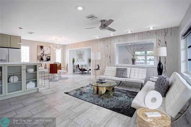 Located In Desirable  East  Wilton Manors, 75 Ft on H2O, Tropical, Gated, Enclave w/  Separate Guest House & Oversized  Resort Style Pool.  Great Entertaining Home.  Both Homes Have Impact Glass Windows; 2 Doors & Laundry Window Have Hurricane Shutters.  12 Yr Old S-Tile Roofs & Separate AC Systems & A 25 KW Gas Stand By Generator / Services Main & Guest House.  Main Home; Open Floor Plan.  New Tile Floors &  Lighting Thru-Out.    Open Kitchen w/  Double Ovens, Quartz Top Counter Bar & Granite On  Other Counter Tops.  Huge Master 22X13 W/ Sitting Area & Wall of  Closets & Floor Safe.  Oversized Bath W/ Double Sinks.  Family Room 25X11 Overlooks Pool & Water,  Dock & Pilings 5 Yrs Old.  Guest House  Great For Elderly Parent, Teenager or Friend in Need.  Lg Laundry Room W/ Plenty Of Storage.