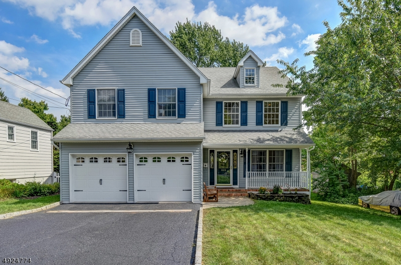 Picture perfect, this engaging colonial has been beautifully renovated in 2017. Finished across three levels, this is a home with exceptional living space both inside & outside, providing space & comfort for everyone in the household. The renovated kitchen featuring new granite counters & new S/S appliances, flows perfectly into the family room w/wood burning fireplace. The 2nd level houses 4 bedrooms & 2 full baths, including the large master suite w/WIC & spa-like bath. The finished lower level includes a rec room. summer kitchen w/dining area, additional bedroom/office, laundry room & walk-out to the newly fenced-in rear yard. This lovely home also features new oak floors on 2nd floor, new light fixtures & crown molding, & newer multi-zone HVAC. Close to downtown Westfield, NYC train, parks & schools.