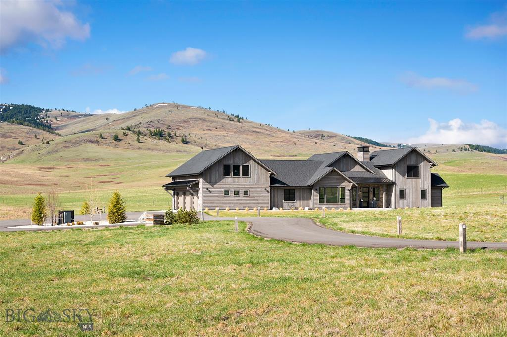 Located at the end of the paved road in the gated community of Montana Ranch, this 2017 custom home abuts a 113,600 acre private ranch.  Enjoy the quiet, privacy, outstanding mountain views and abundant wildlife from the patio of this thoughtfully designed and meticulously crafted home.  Sleek simplicity and elegantly subtle detailsdefine this home that fits beautifully into the Montana terrain.