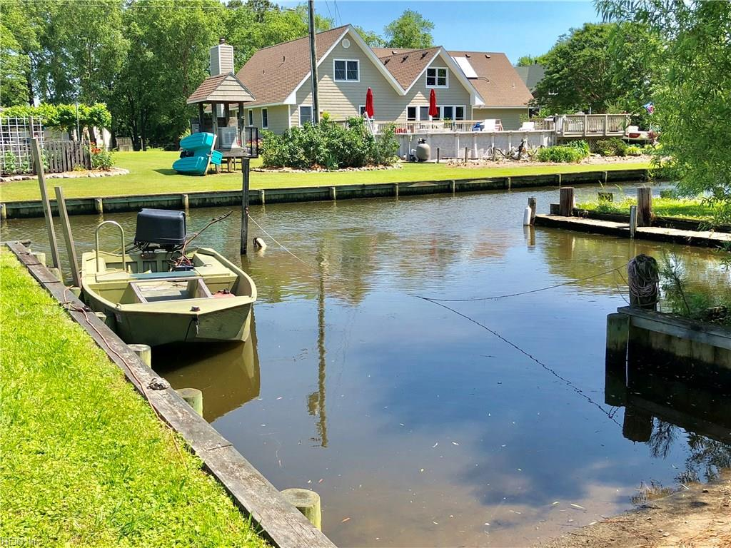 Waterfront canal on Capps Creek. Stick built  home on a brick crawl. House has only been used during duck hunting season and shows new. Lot is bulk headed and also has a boat ramp. The entire upstairs is unfinished with a bathroom plumbed. Master bedroom has a full bath and a view of the canal. Two additional bedrooms are down as well as a full bath. Kitchen is open to large living room with a gas stove and stainless appliance. House basically looks brand-new on the inside. Large storage shed new the water is perfect for lawn equipment or decoys. Nice deck in the back over looks canal and is perfect for entertaining and cookouts.