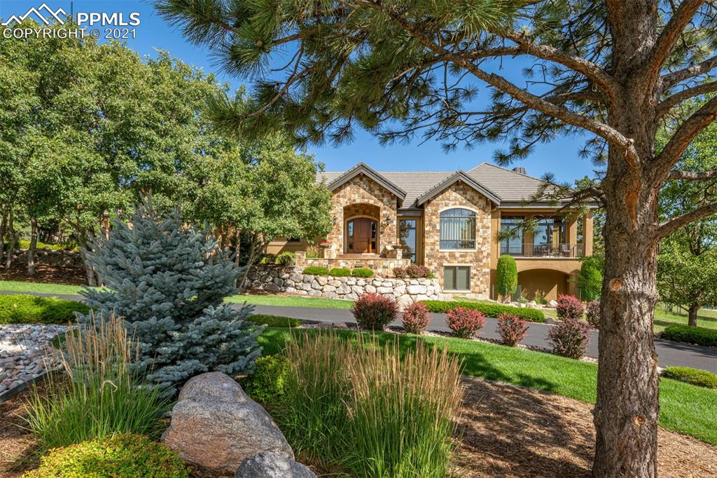 "*** FIRST TIME EVER ON THE MARKET *** This one-owner custom-built Nichols & Comito home was thoughtfully designed by noted architect Todd Brokaw and is a paragon to the highest quality of construction and craftsmanship * Tucked away in the foothills on 1.26 acres amongst evergreen and deciduous trees in the prestigious gated community of Stratton Preserve * All-season (covered) stamped-concrete patio with wall-of-stone Isokern fireplace plus a built-in Lynx grill * Soak in the serenity as you look out on the professionally landscaped HUGE FLAT YARD with lush green sod framed by stacked stone plus firepit, trampoline, and PRIVACY * Gourmet eat-in kitchen with custom knotty alder cabinetry, Thermador 6-burner range + double oven + warming drawer, 48+ SubZero refrigerator, under-counter wine fridge, dual Bosch dishwashers, huge pantry, and instant hot water * Natural stone curb appeal carries through to interior entry and main fireplace * Knotty alder beams, doors, and trim throughout * White oak floors * Five-piece master suite with fireplace and spacious walk-in closet * Great room with refrigerator drawers for relaxing refreshment * FOUR FIREPLACES * Fun & functional walkout lower level with wet bar (incl. DW and fridge) & rec room * Insulated & oversized garage * Incredibly convenient location – very close to ALL levels K-12 of award-winning Cheyenne Mountain District 12 schools * Short walk to trail head for beautiful hiking though the wooded acres of the Stratton Open Space! * Just minutes from the Broadmoor Hotel, Bear Creek Park & Bear Creek Dog Park, US Olympic Museum, Old Colorado City, and Downtown * Steam shower in lower level for workouts * Large ""drop zone"" with walk-in closet and built-in shelves * Service stairs from garage to lower level * COVETED OPTION to build an additional structure on the lot for guest quarters, detached garage, etc. * Framed & ready for FUTURE ELEVATOR * Naturally chilled room for future wine cellar * SEE FEATURE SHEET IN DOCS *"