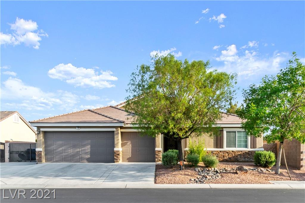 This Amazing Tule Springs Single Story Home sits on a spacious corner lot with no neighbors on one side. Located in the sought after Log Cabin Ranch Community and in Arbor View High School zone. Two of the three bedrooms are primary bedrooms, each with their own walk-in closets. The den can easily be converted in to a 4th bedroom. It is equipped with new upgrades that include a beautiful modern inground Pool and Spa built in 2018, custom closets (2020), exterior paint (2020), Alumawood patio covering (2016), interior paint, and a new microwave (2020). In addition to all of the home's features it also has gated RV parking!