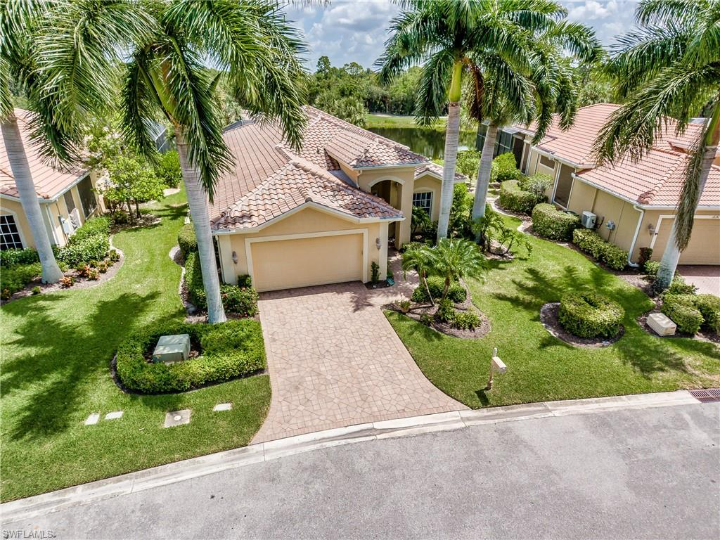 "H.16089 -  A true gem!  Experience breathtaking lake and golf views from your private lanai.  The open floor plan provides a picturesque view of the 12th green of The Preserve golf course across the lake.  This sensation by Taylor Woodrow offers a huge master suite, two guest bedrooms, den, living room, morning room and kitchen with breakfast bar.  Sliding glass doors in the family room merge the luxurious lanai with the interior of the home, custom pool and a truly superior view.  Kitchen boasts under-cabinet lighting, granite countertops, an island, pantry, 41"" custom cabinets and a transom window.  Crown molding, 5"" base boards, attractive porcelain tile throughout the house.  Wired for sound inside and outside.  High ceilings and wide hallways make this home feel expansive.  Enjoy small community ambiance with large community amenities.  Shadow Wood Country Club offers 54 holes of championship golf, 2 club houses, 9 Har Tru tennis courts, bocce, pickle ball, access to a private beach club, fitness center, full service spa and private restaurant, plus on-site, free use of fishing pier, kayaks and canoes. Close to shopping, airport, beaches and much more."