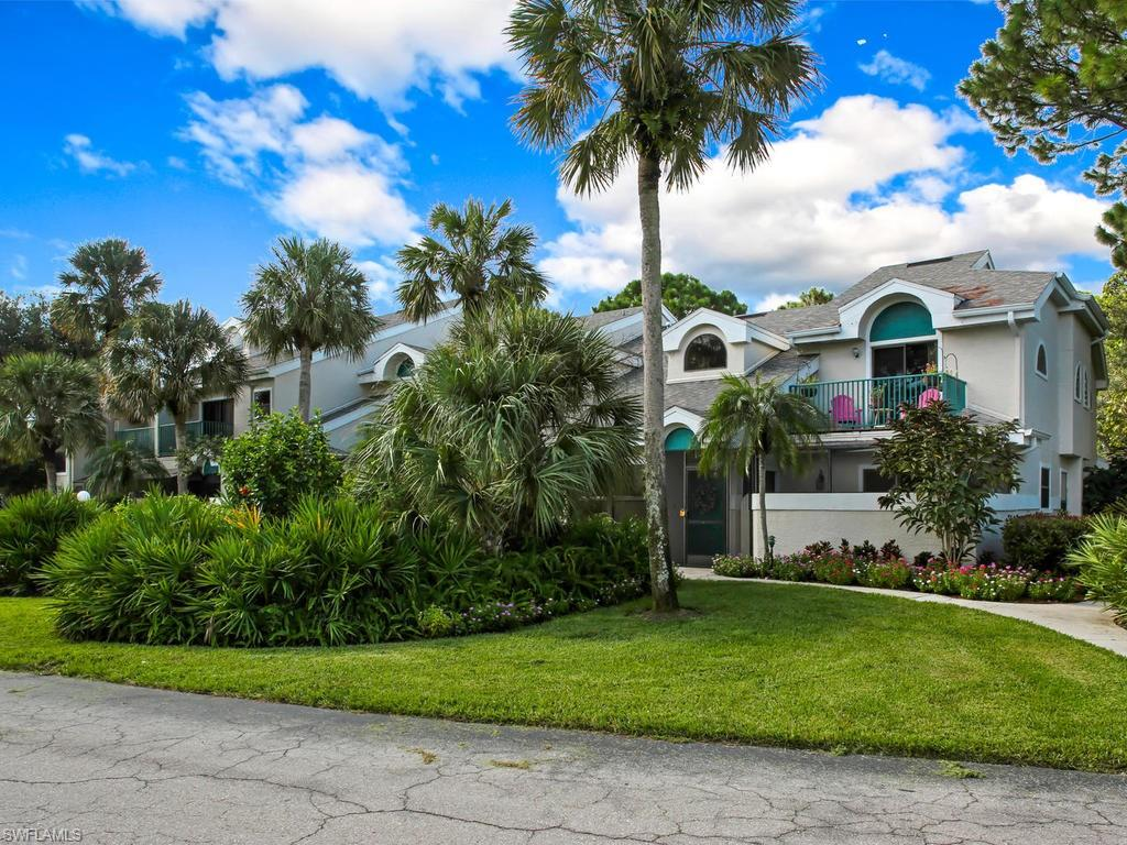 A secluded tropical get-away in the heart of North Naples!! Enjoy the lush foliage and quiet environment of this beautiful 2-bedroom/2.5-bath condo, while also having incredibly easy access to some of the best shopping and beaches in the Naples area! The first floor offers an open floor plan and vaulted ceiling, convenient powder room, full-sized laundry, and a large master suite with sliders onto the private screened lanai. Enjoy your morning coffee or evening cocktails with friends in the lanai that's almost as large as the living room! Upstairs is another master suite with balcony, plus a large loft den and huge storage closet. Kitchen has quartz countertops and recent appliances; water heater is brand new in 2019--and moved to the ground floor from the attic; large storage closet on the lanai. And you're across the street from the delightful clubhouse and pool where your friendly neighbors gather for both lively social events and luxurious poolside relaxation!