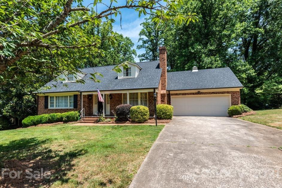 Prime location just steps from Lake Hickory Country Club. The  .3 mile walk down the road will allow you access to the country club's restaurants, golf, pool and tennis. The Moss Marlow built 1971 Cape Cod home offers spacious room throughout. Main floor includes eat-in kitchen, family room, living room, dining room, primary bedroom and full bath. Upstairs are two more bedrooms, a full bath and a storage closet. The basement level offers great potential for recreational/flex space. The back yard continues to the adjacent street. So much potential to make this your dream home with a location that doesn't become available often. Agent is related to seller.
