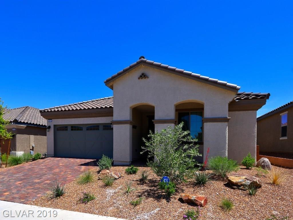 BUILT IN 2018, 1 Story, GATED Community in Inspirada! Fantastic deal for turn-key home w/builders warranty. Neutral colors w/tile throughout, no carpet! Popular 3 bedroom + den model, OPEN floor plan, vaulted ceiling. Huge kitchen breakfast bar w/large walk-in pantry and ALL APPLIANCES INCLUDED!  Master suite with walk-in granite shower.  Tankless water heater, water softener, ceiling fans, security door, alarm & blinds already installed for you!