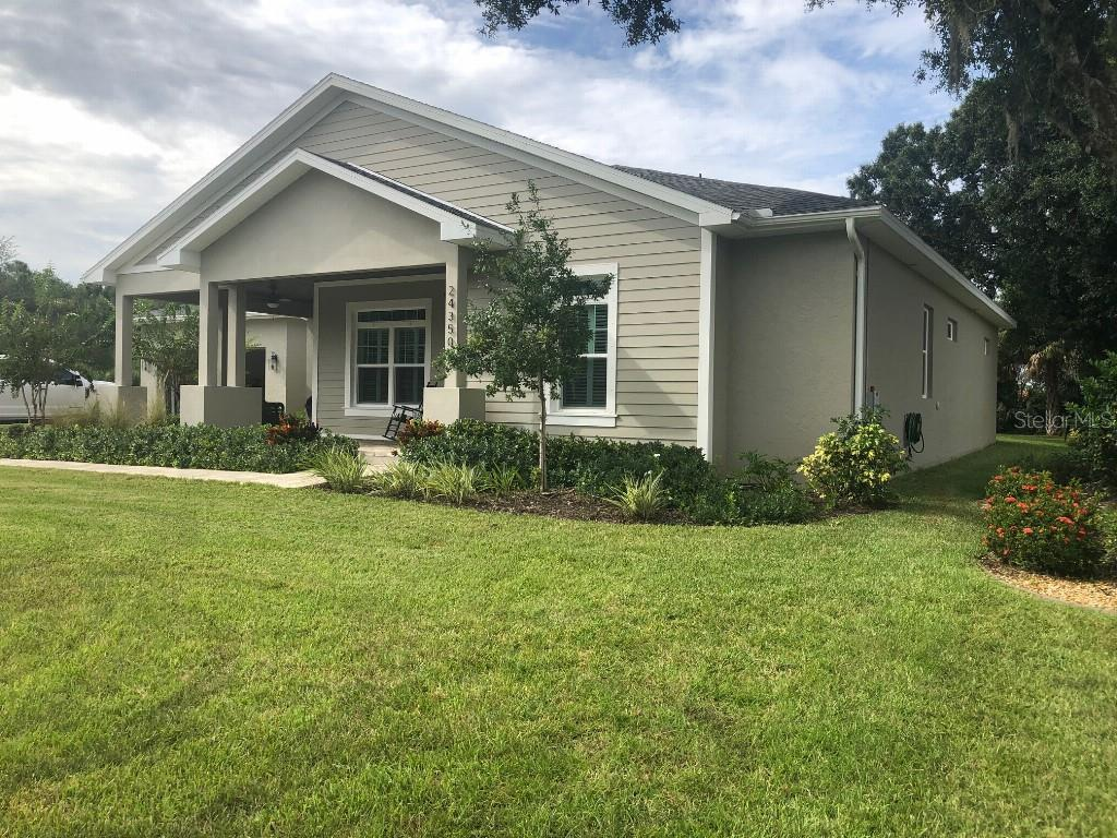 Super convenient location. Less than a mile off I-75 and close to Publix and other conveniences as well as being a short ride to downtown historical Punta Gorda with its restaurants, farmers markets and activities. House is like new yet better with all of it's personal touches that make it a home, like a fireplace, built in bookcases, molding and coffer ceiling. There is a large front porch with paver bricks and a tung and grove ceiling to welcome you. Inside you will find a modern open floor plan with a fabulous kitchen with Kitchen-aid appliances, large island, wine cooler, granite counters and much more. Three bedrooms and 2.5 baths on a quiet lot backing up to the soon to be Allegiant golf course.